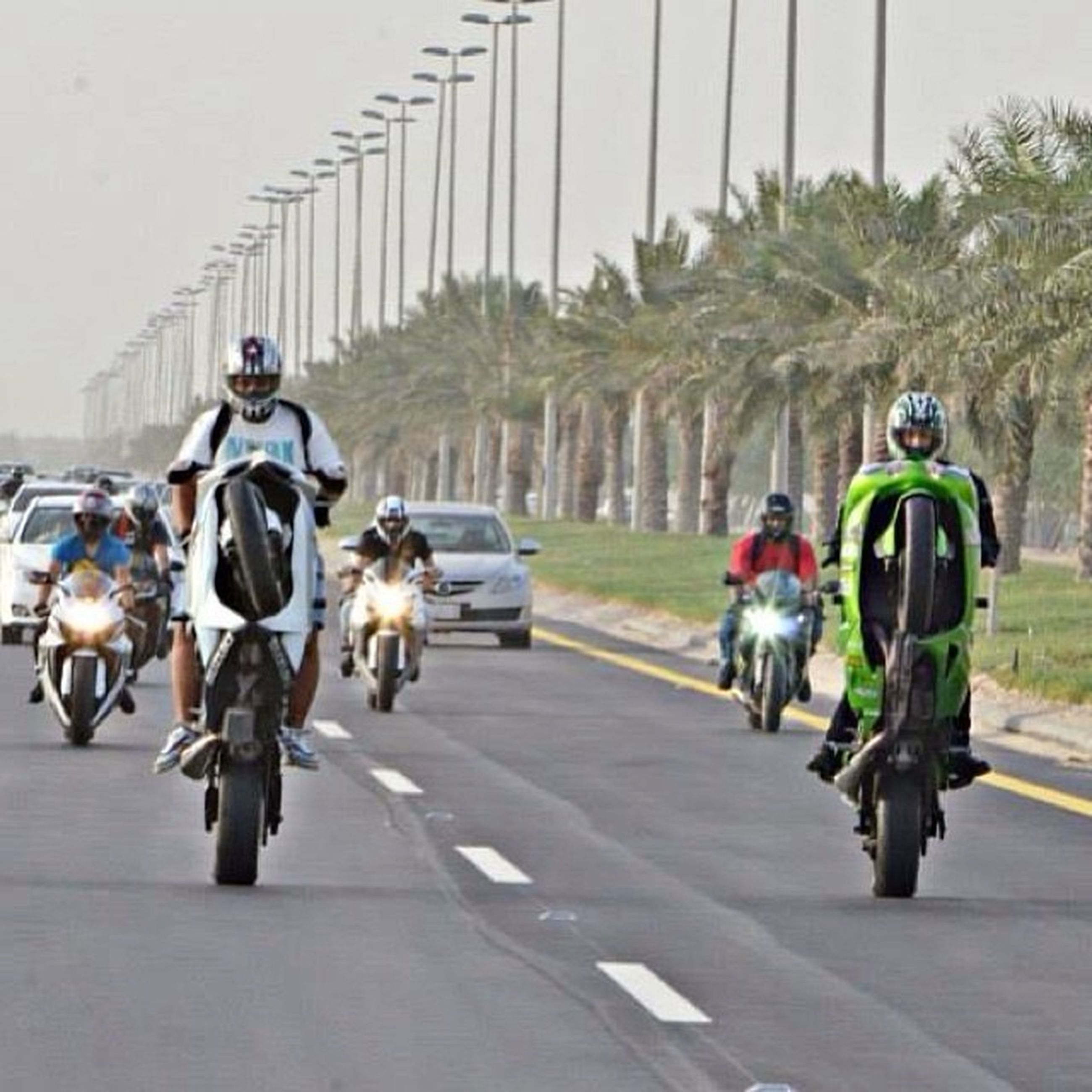 riding, full length, transportation, lifestyles, bicycle, land vehicle, leisure activity, road, men, street, mode of transport, casual clothing, cycling, walking, the way forward, on the move, day, togetherness, person