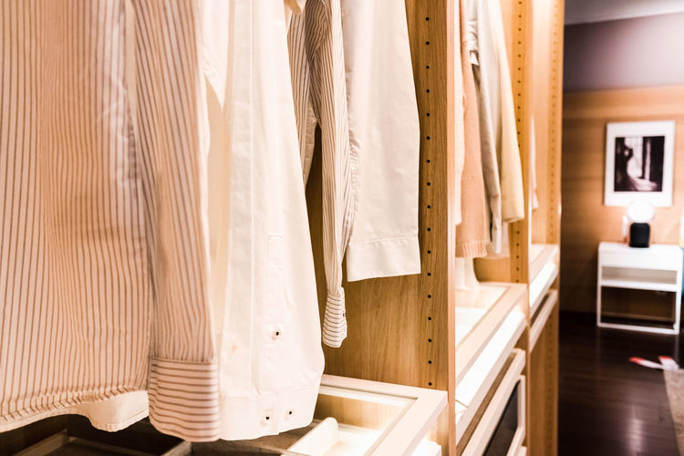 Clothes hanging on wall at home