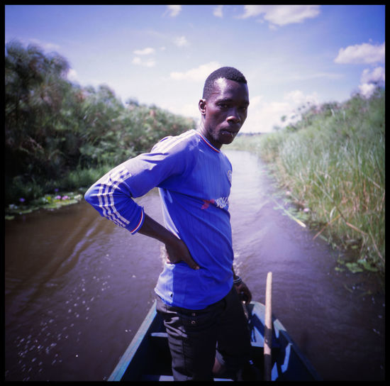 The proud faces of bussi island in victoria lake 120 Mm Analogue Photography Boy Bussi Island Dance East Africa Ferry Man Girl Island Joy Kids Life Lomography Medium Format Outdoors Slide Smile Summer The Photojournalist - 2017 EyeEm Awards The White Hat Travel Uganda