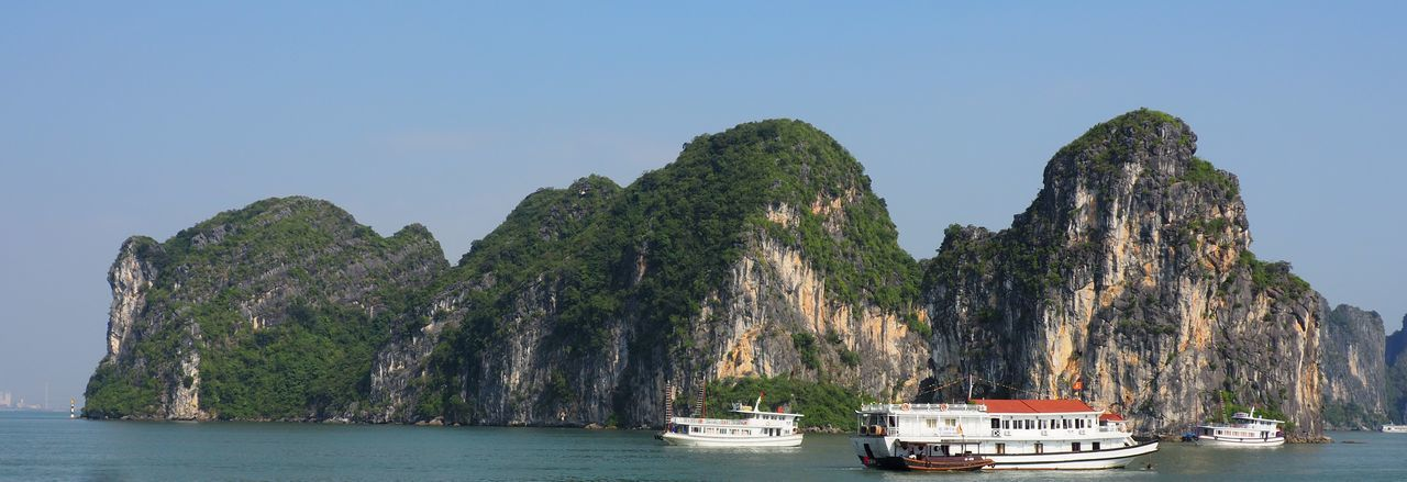 Ha Long Bay Nautical Vessel Sea Beauty In Nature Mountain Clear Sky Scenics - Nature Transportation Water Karstic Rock Formations