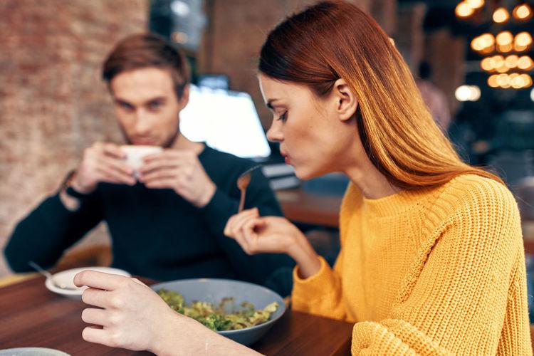 Couple having food at restaurant