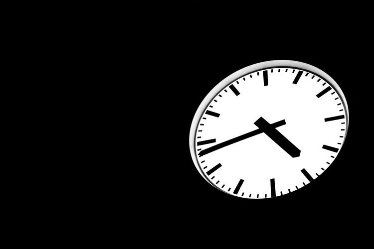 Public illuminated analog round clock against dark night Time Clock Circle White Color Wall Clock Dark Night Copy Space Analog Illuminated Outdoors Business Schedule Stress Sign Symbol Future Watch Planning Concept Classic Public Black Color Black Background Cut Out