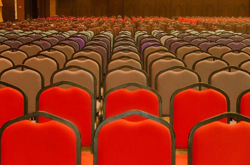 Empty chairs arranged at auditorium