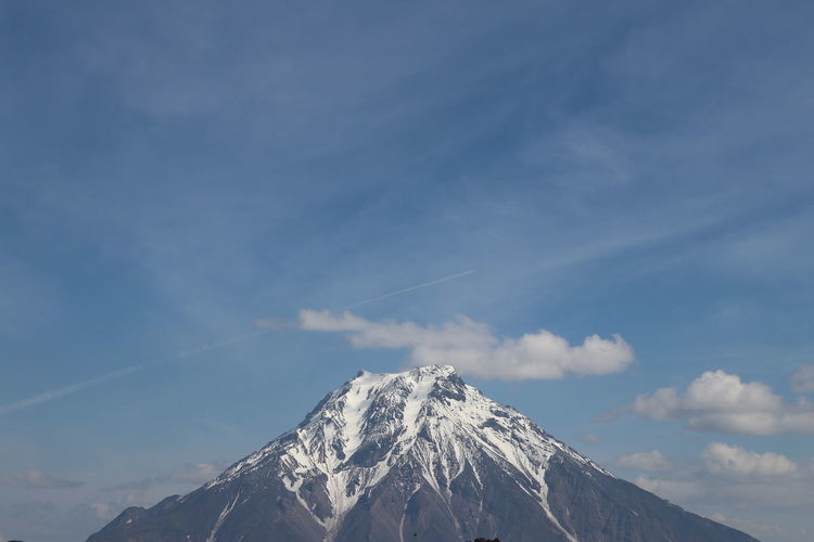 Panoramic view of volcano against sky