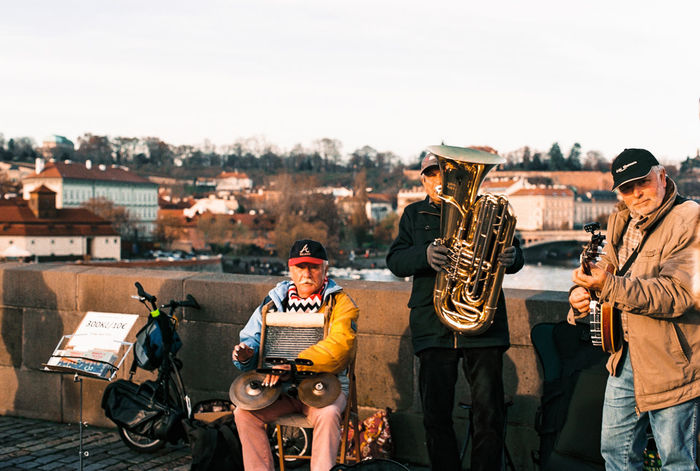 Analogue Band Cozy Film Photography Houses Men Musical Instrument Musician Outdoors People Plague Sunset Travel View