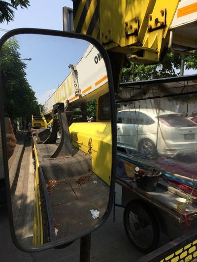 Mode Of Transportation Transportation Land Vehicle Car Yellow Day Motor Vehicle Glass - Material Reflection No People Nature Travel Sky Outdoors City Stationary Road Street Plant Junkyard Mirror