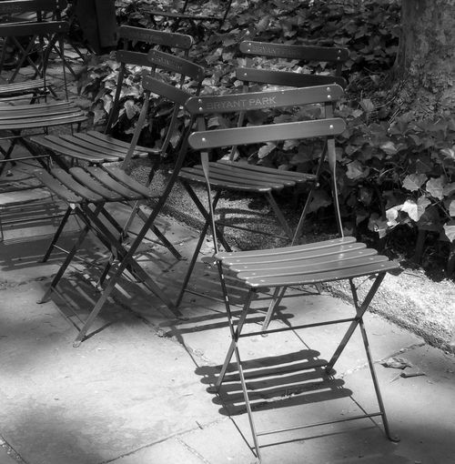 Bryant Park NYC Calmness Manhattan Resting Place Black And White Chair Day Flower Light And Shadow Nature No People Outdoors Resting Table