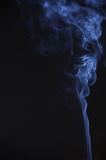 aroma smoke on the black background Smoke - Physical Structure Black Background Studio Shot Indoors  Copy Space Close-up Motion No People Abstract Nature Pattern Swirl Moving Up Incense Burning Cigarette  Changing Form Blue Curve Heat - Temperature Environment Flowing Luminosity