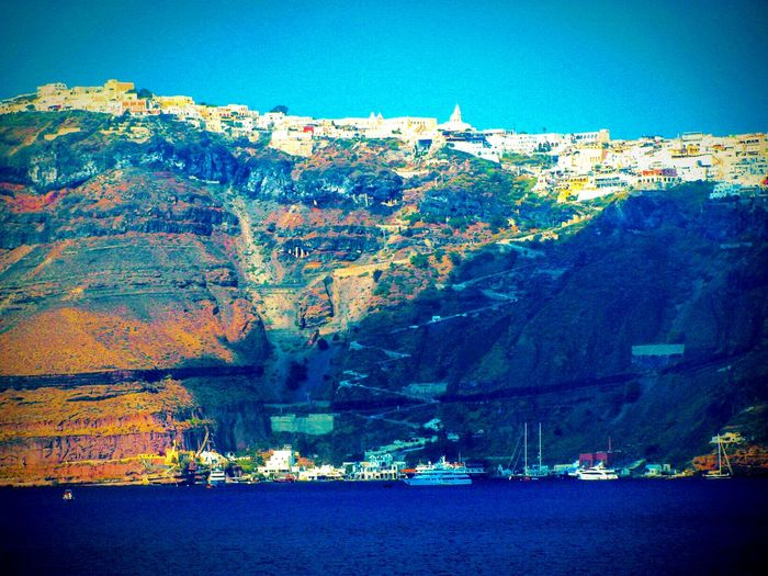 Seeing The Sights Volcanoes Village Port Sea The Best From Holiday POV Greek Islands No People Summer Holidays Ships Cliff Steep Caldera On A Boat Shadows Shades Of Blue Athinios Port Fira Santorini Island Summer Memories 🌄 Landscapes With WhiteWall