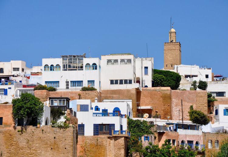 Residential Buildings Against Clear Blue Sky