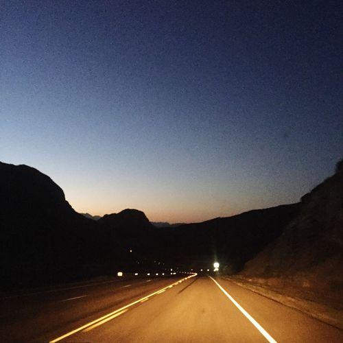 Driving in sunrise time, still dark, mountain silhouettes Mountain View Sunrise Silhouette Photography