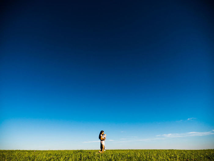 Mother and her daughter. Alone Baby Daughter Grass Hope Landscape Melancholy Mother Power Sky Walking Woman