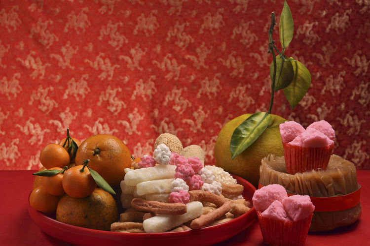 Chinese New Year traditional sweet rice cake Atmosphere Dessert Jujube  New Year Orange Chinese New Year Close-up Day Food Food And Drink Freshness Fruit Fruits Healthy Eating Indoors  Joy Mochi No People Pastry Peanut Candy Plate Ready-to-eat Rice Cake Sweet Food Traditional Dessert