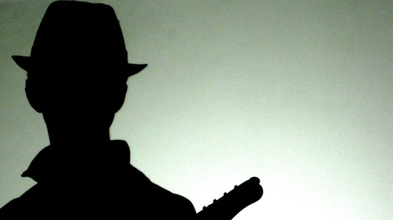 Backlit Subject Guitar Low Angle View One Person People Real People Shadow Silhouette Sky