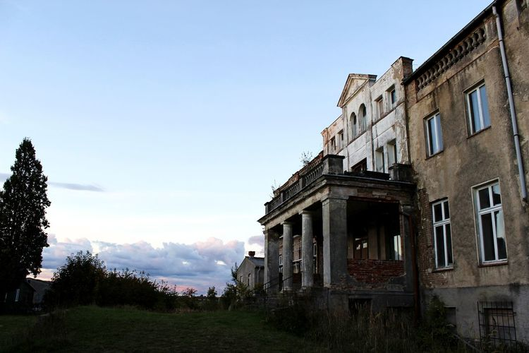 Abandoned Abandoned Buildings Abandoned Places Architecture Blue Building Building Exterior Built Structure Day Exterior Grass Nature No People Old Old Times Outdoors Past Sky Sunny Travel Destinations Vintage Cars Vintage Old
