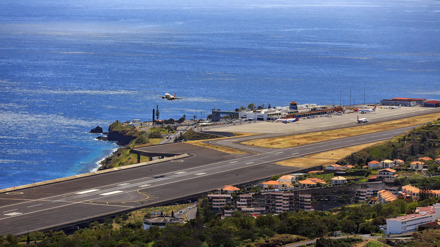 Holiday Island Airport Toronto Madeira Take Off Vacation Time Vacations Air Vehicle Airplane Airplanes Airport Airport Runway Day Departure Departure Times Flying High Angle View Island Madeira Airport Mode Of Transportation Public Transportation Sea TakeOff Transportation Vacation Water