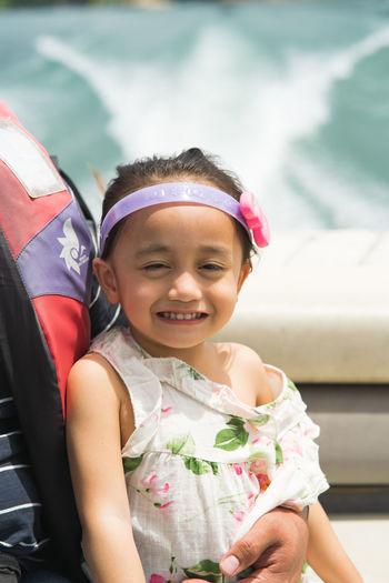 Portrait of cute girl smiling in boat