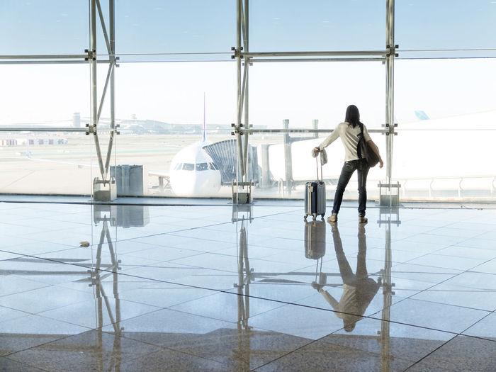 Rear view of woman at airport runway
