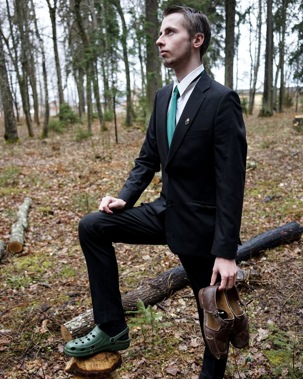 one person, forest, tree, full length, leisure activity, young men, autumn, young adult, lifestyles, men, outdoors, suit, side view, day, holding, handsome, nature, real people, standing, branch, portrait, businessman, one man only, adult, people