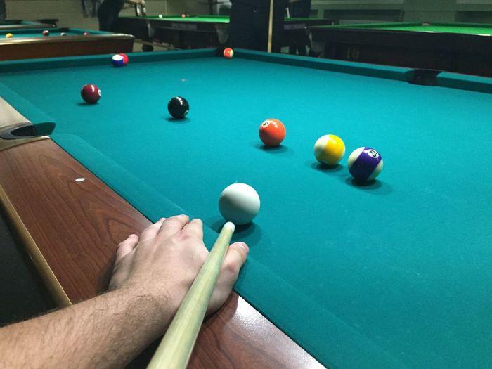 Cropped image of man playing pool