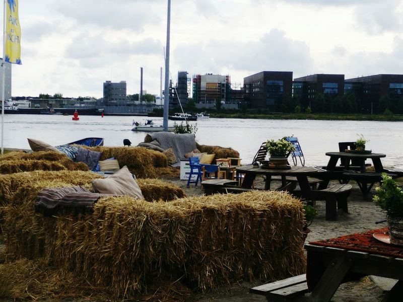 Cloud - Sky City Sky Travel Destinations No People Day Outdoors Nature Architecture Haystacks Riverside River Ferry Tables Tables And Chairs