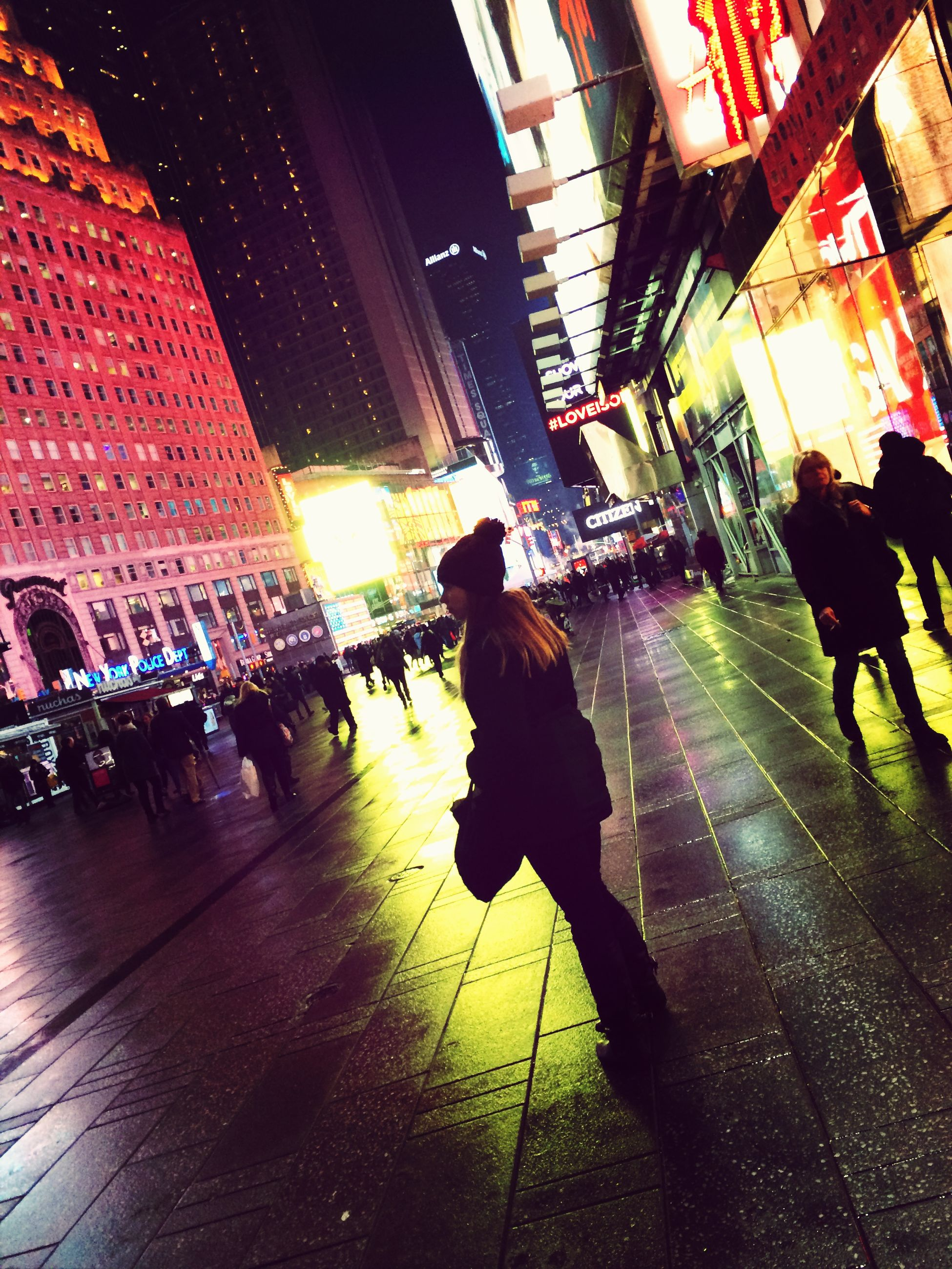 architecture, building exterior, lifestyles, built structure, walking, men, person, night, illuminated, city, street, city life, leisure activity, full length, large group of people, building, umbrella, shadow, standing