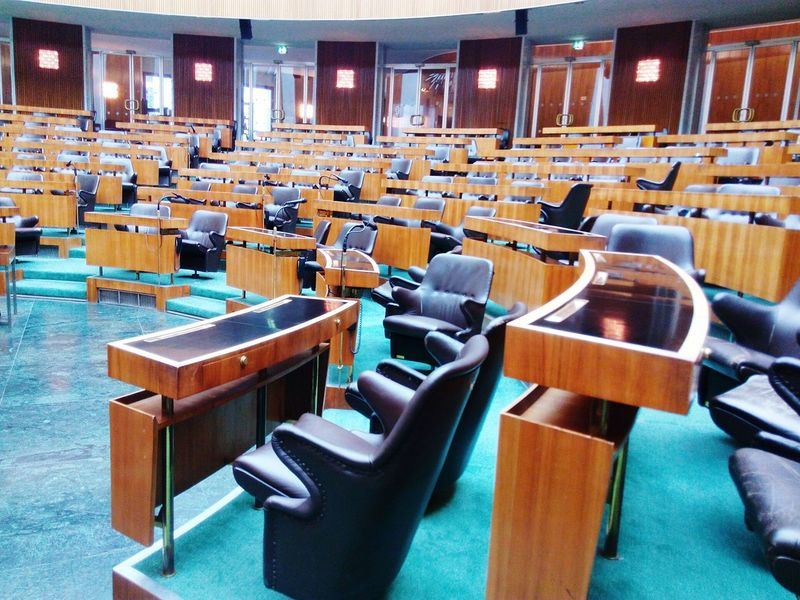 EyeEm Selects Chair Seat In A Row Empty Auditorium Large Group Of Objects Indoors  Seminar Illuminated No People Stage - Performance Space Arts Culture And Entertainment Business Lecture Hall University Day Courtroom Politics And Government Film Industry