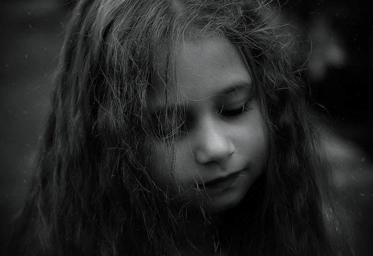 Close-Up Of Sad Girl Standing Outdoors