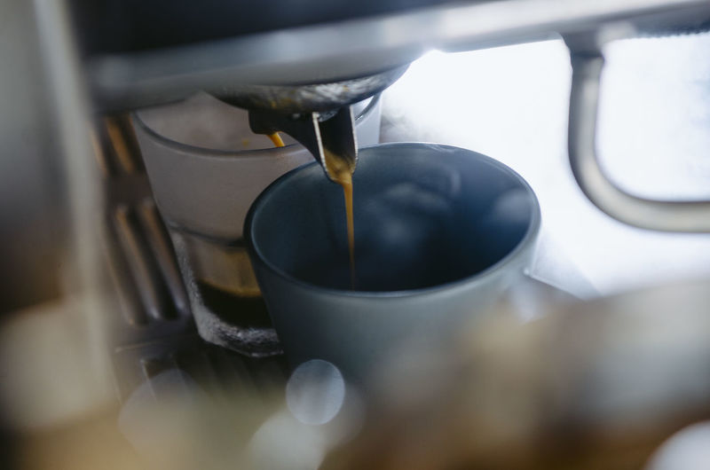 Coffee Coffee - Drink Close-up Selective Focus Coffee Cup Food And Drink Cup Coffee Maker Mug Drink Indoors  Refreshment No People Pouring Preparation  Motion Appliance Machinery High Angle View