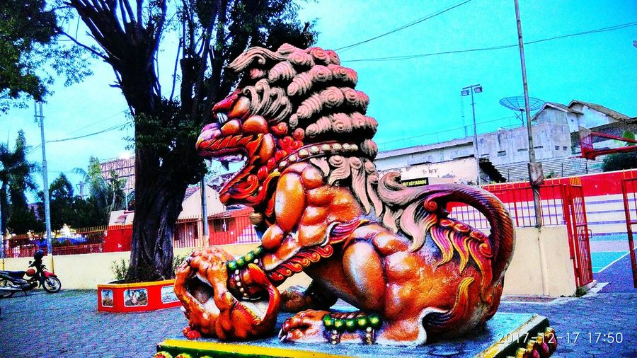 Liong Graffiti Day Outdoors Street Art Multi Colored Built Structure No People