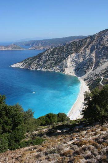 beautiful beach in kefalonia greece Kefalonia, Greece Beach Beauty In Nature Day Landscape Mountain Nature Outdoors Rock - Object Sand Scenics Sea Sky Torquoise Sea Tree Water