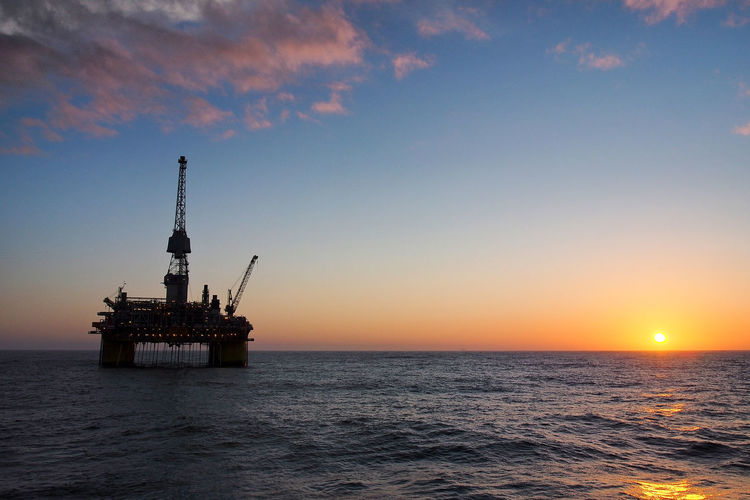 An oil and gas rig view taken during sunset in Norway. Offshore Production Drilling Drilling Rig Engineering Exploration Fuel And Power Generation Industry Offshore Platform Oil And Gas Oil And Gas Industry Oil And Gas Rig Oil Industry Petroleum Petroleum Engineering Petroleum Industry Sea Sky Sunset