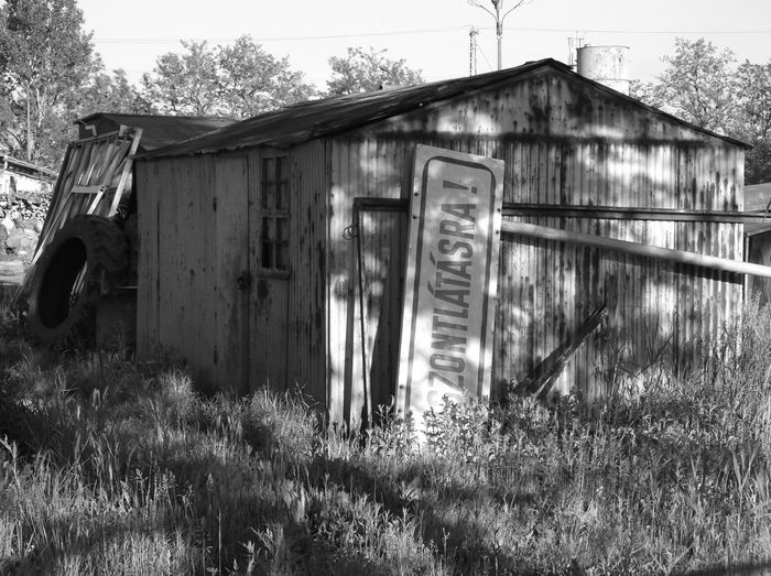 Scrapped old traffic sign in the backyard of a town warehouse with the word 'Farewell' on it. Architecture Blackandwhite Blackandwhite Photography Day Hungary No People Old Outdoors Scrap Traffic Sign Tree Yard