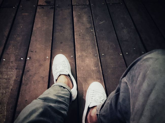 TakeoverContrast Personal Perspective Casual Clothing Wood Paneling Footwear White Shoes Person Low Section Personal Perspective Standing Shoe Lifestyles Leisure Activity Men Hardwood Floor Footwear Human Foot Casual Clothing Day Wood Paneling Limb