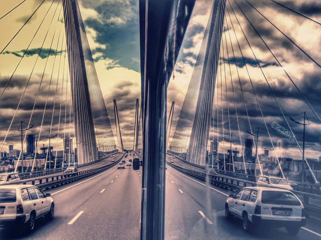 transportation, car, mode of transport, land vehicle, road, traffic, street, outdoors, suspension bridge, city, no people, sky, bridge - man made structure, day, architecture, nautical vessel