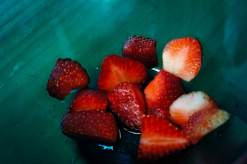 piece of strawberry in the bowl Beautiful Lifestyles Art Abstract Light Food EyeEm Selects Strawberry Fruit Food Food And Drink Red Healthy Eating Indoors  Freshness No People Sweet Food Water Close-up Frozen Food Ready-to-eat Day