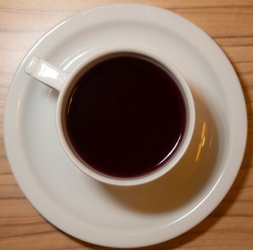 Drink Food And Drink Refreshment Cup Mug Table Coffee Coffee - Drink Coffee Cup Freshness Indoors  Hot Drink Tea Crockery Close-up Directly Above No People Black Coffee Still Life Tea - Hot Drink Saucer Tea Cup Black Tea Non-alcoholic Beverage Wood Grain
