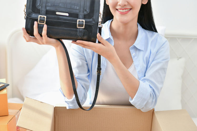 Adult Box Box - Container Cardboard Cardboard Box Carrying Casual Clothing Front View Holding Indoors  Lifestyles Midsection Packing People Smiling Standing Two People Uniform Unpacking Women Young Adult Young Women