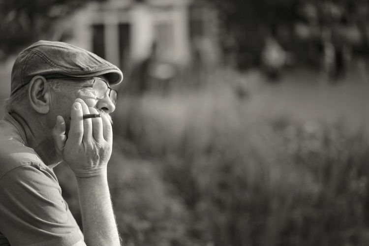 Close-up of thoughtful senior man against blurred background