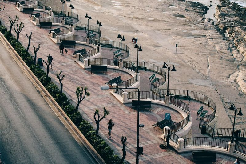 High Angle View Of Observation Point At Promenade By Low Tide Sea