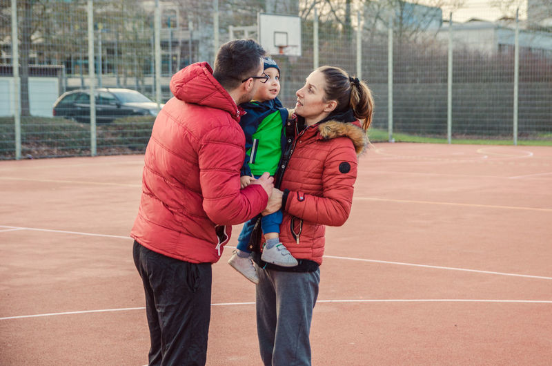 The center of two Universes. Family Mother Father Son Happy Happiness Storytelling Family Portrait This Is Family Tennis Court Young Women Sports Clothing Sport Togetherness Track And Field Stadium Sportsman Smiling Bonding Young Couple Falling In Love Arm In Arm