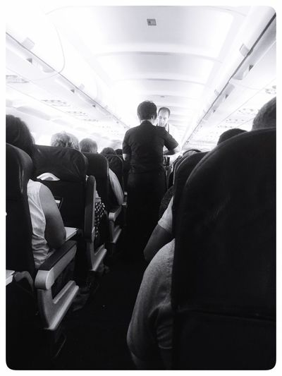 In Flight on an aircraft / airplane Passengers Airplane In Flight Black And White Commercial Airlines