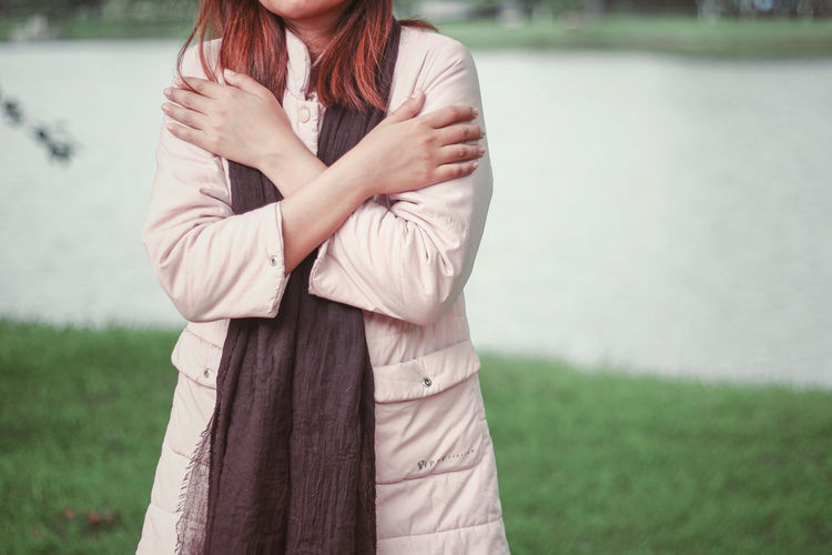 Midsection of woman standing outdoors during winter