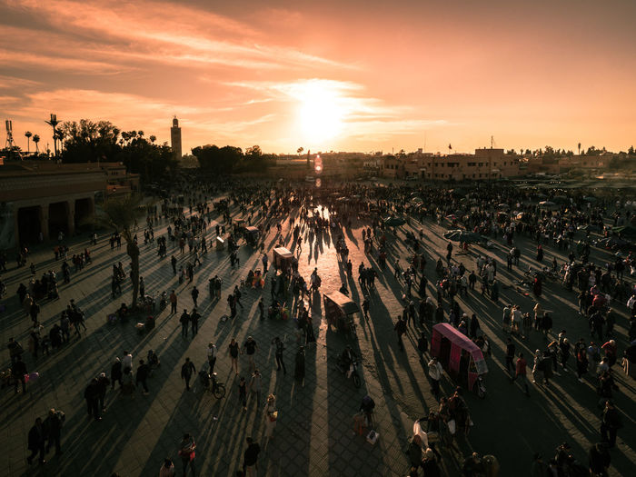 High Angle View Of People On Street In City During Sunset