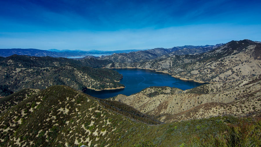 Aerial view of Lake Berryessa from the first viewpoint of the Blue Ridge Trail loop going clockwise, Stebbins Cold Canyon, on a sunny day, featuring the surrounding blue oak woodland in the fall of 2017 Scenics - Nature Water Tranquil Scene Sky Beauty In Nature Tranquility Mountain Blue Non-urban Scene Nature No People Lake Idyllic Day Environment Remote Geology Landscape Outdoors Lake Berryessa Berryessa Blue Ridge Mountains Trail Stebbins Cold Canyon Cold Canyon