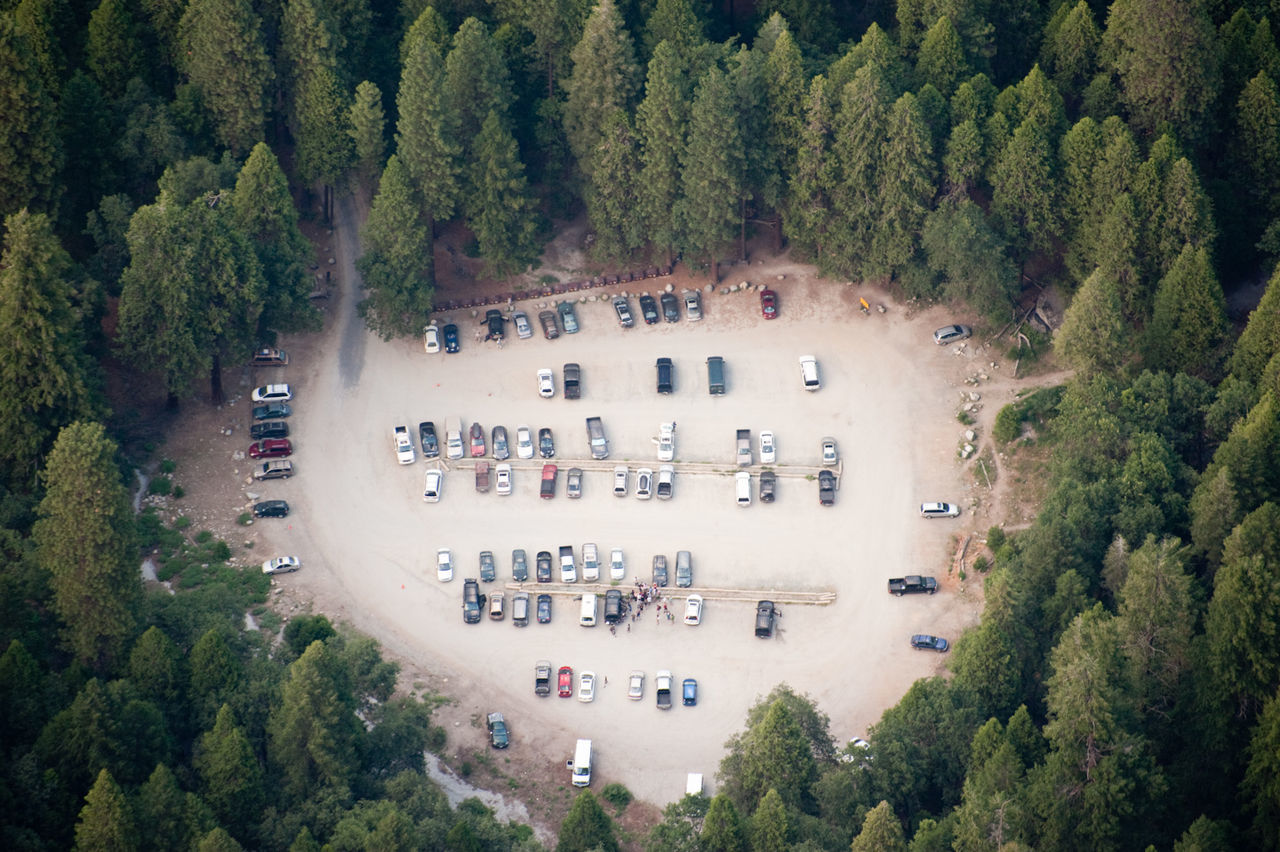 Parking lot in a forest seen from above