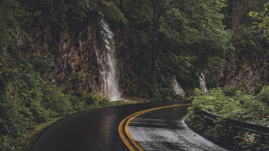 Waterfalls on mountain by road