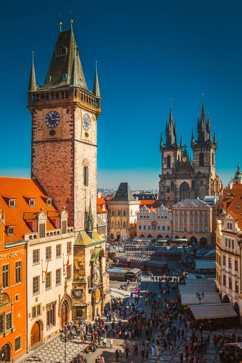 Architecture Astronomical Clock Building Exterior Built Structure City Clear Sky Clock Tower Day History Large Group Of People Outdoors People Place Of Worship Prague Real People Religion Sky Spirituality Tourism Tower Town Square Travel Destinations