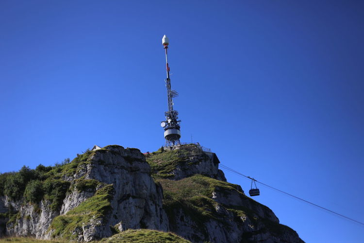 Low Angle View Of Communication Tower On Cliff Against Clear Sky