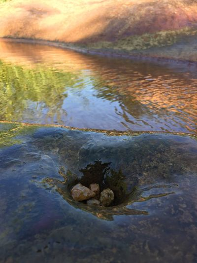 Water Tranquility Reflection Tranquil Scene Scenics Nature Beauty In Nature Non-urban Scene Outdoors Sun Majestic Standing Water Countryside Green Green Focus On Foreground Growing Stone No People Rock Full Frame Multi Colored Floating On Water Rocky Day